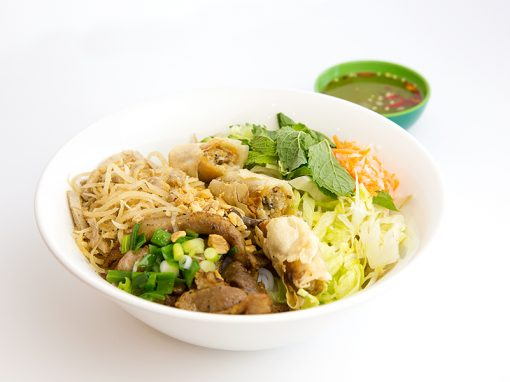 Vermicelli with grilled pork chop spring rolls and shredded pork skin