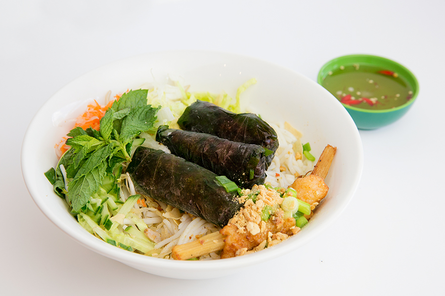 Vermicelli with grilled spicy beef wrapped in herb leaves