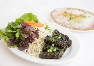 Grilled spicy beef wrapped in herb leaves served with vermicelli and rice paper